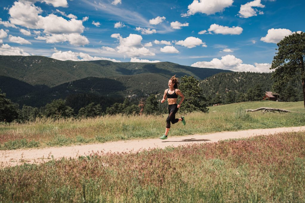 Woman running on a Colorado trail near The Canyons