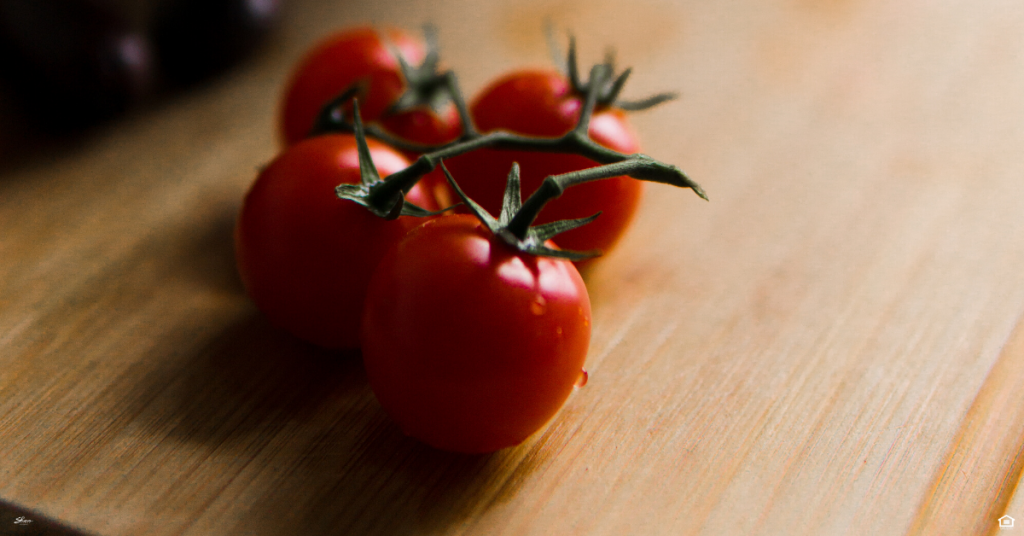 Ripe tomatoes on a cutting board