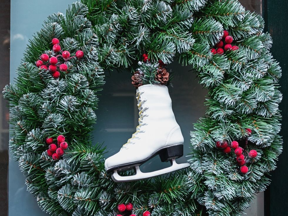 Oversized Christmas wreath with a figure skate in the middle