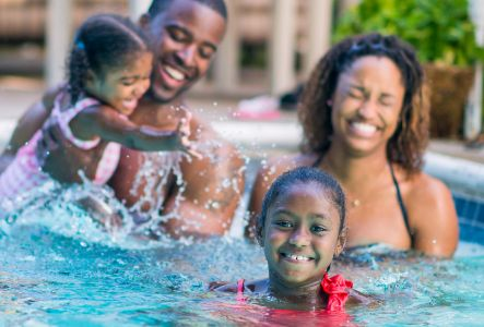 A family playing in the pool | The Canyons | A new home community in Castle Pines, CO