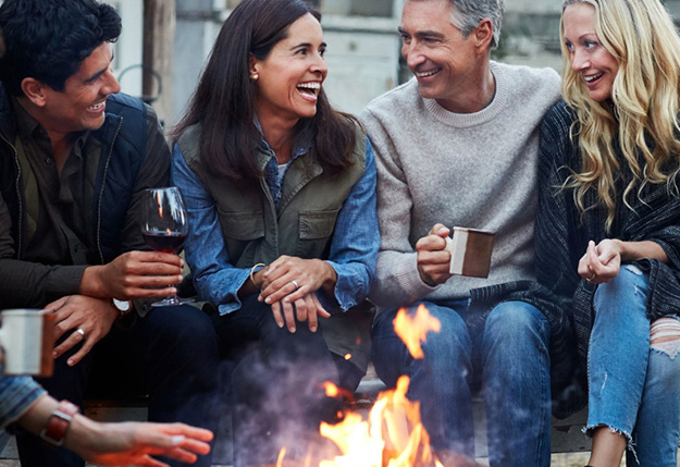 Adults sitting around a fire pit | The Exchange Coffee House | The Canyons, a new home community in Castle Pines, CO
