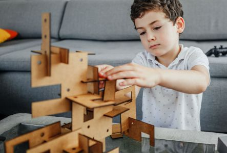 A young boy playing at the Kid's Zone | The Canyons | A new home community in Castle Pines, CO