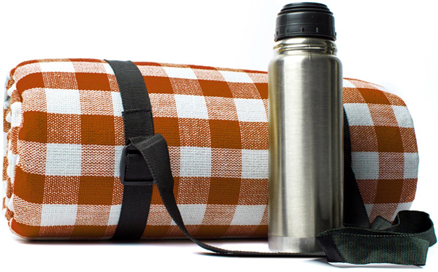 A picnic blanket and thermos | Commons Park at The Canyons | A new home community in Castle Pines, CO